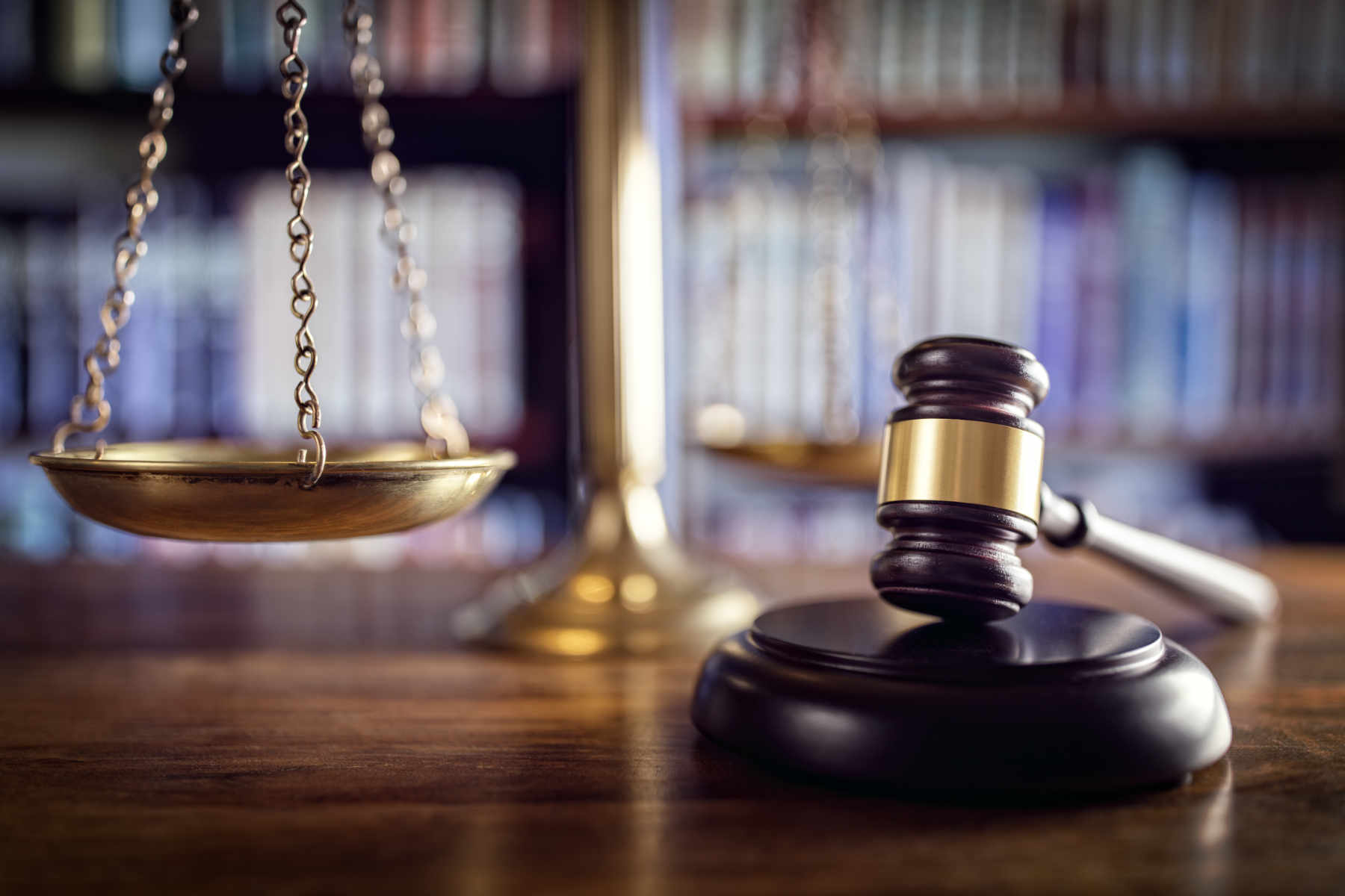 Image of gavel and scales of justice as concept for wise living over 50s legal guides - from consumer rights and online scams to money and property legal guides