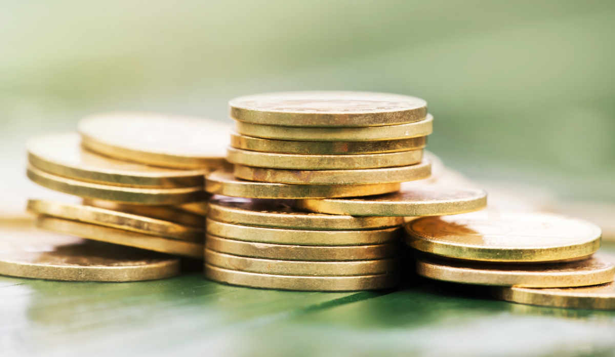 Image of coins as a concept for making the most of your savings, investments, pension and insurance with wise living money retirement guides