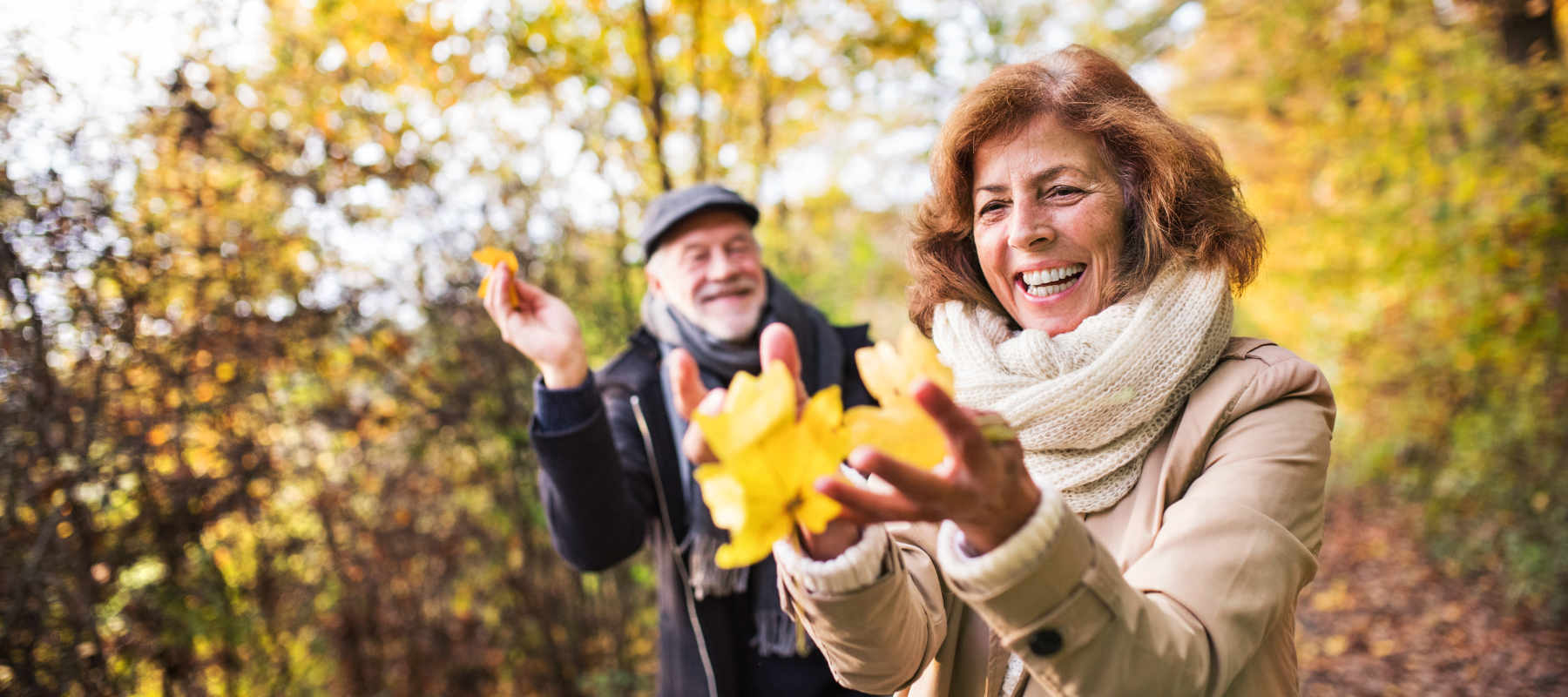 Image of a senior couple in an autumn forest as a concept for getting the best from pension planning and retirement - from pension drawdown to retiring to Spain - with wise living retirement guides