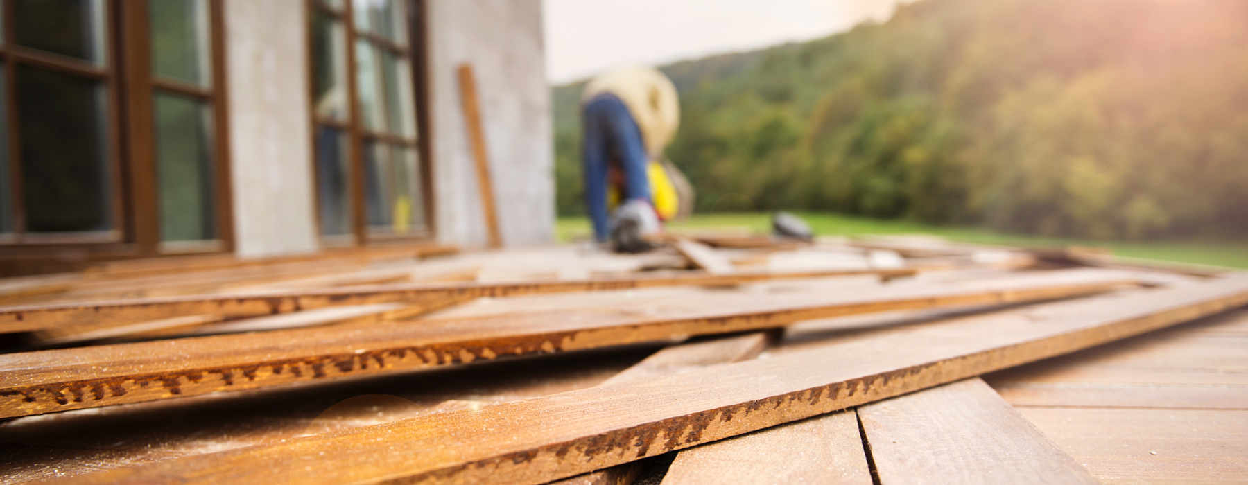 Image of senior building a wooden deck as concept for wise living over 50s home guides - from energy saving tips to loft insulation