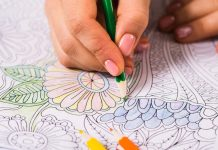 Image of a woman using an adult colouring book as one way to improve brain health