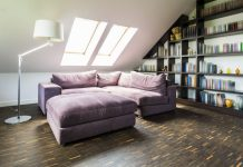 Image of a loft conversion to help stimulate loft conversion ideas showing a bed, storage and wooden floor