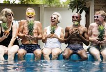 Image of happy seniors sitting poolside looking healthy and alert thanks to techniques to improve memory and brain health