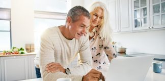 Image of senior couple using a laptop to over over 50s home insurance online