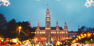 Image of Christmas market breaks by air showing a lit up Christmas tree and town square