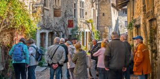 Image of a group of seniors in Perouges, France as part of an escorted holidays tour