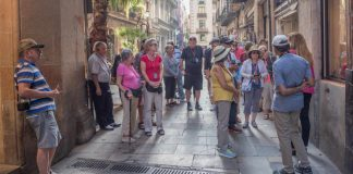 Image of a group of senior tourists on escorted tours in El Born, Barcelona