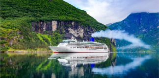 Image of a cruise ship on Geiranger fjord, Norway, typical of a last minute cruise deals bargain holiday