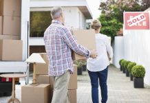 Image of a senior couple moving home using removal companies for removal and storage