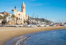 Image of a Spanish beach and town if you're thinking of retiring to Spain from UK