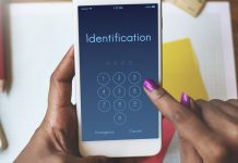 Woman with mobile phone and PIN for article on what is identity theft
