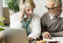 Image of a senior couple using a laptop to decide where to invest a lump sum of money