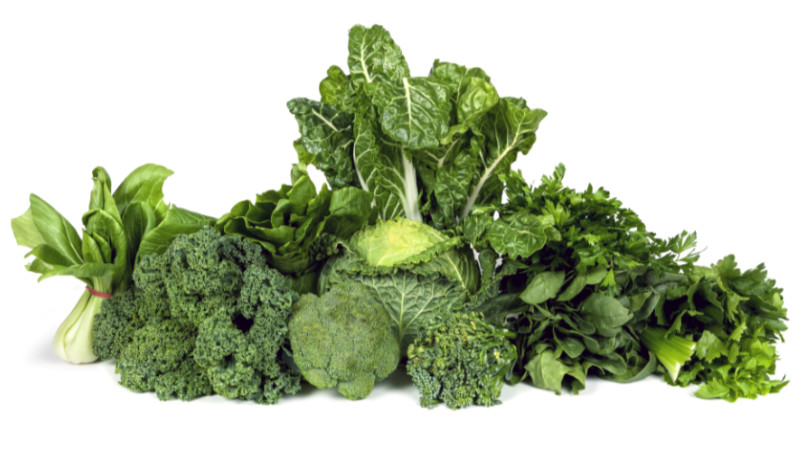 Brain food - Variety of leafy green vegetables isolated on white background.