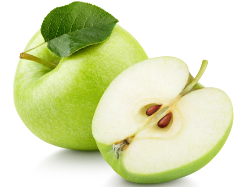 Prebiotic foods – Ripe green apple fruit with apple half and green leaf isolated on white background.