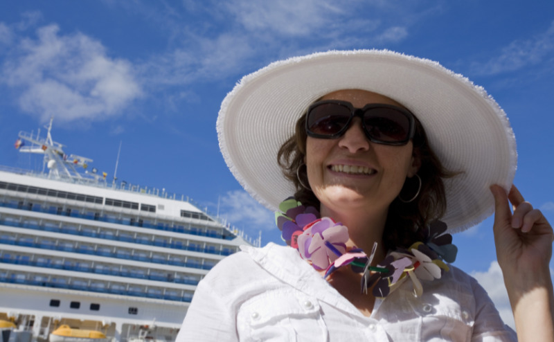 Solo cruise tips – smiling woman in Cruise vacation.