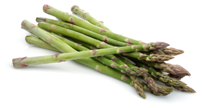 Prebiotic foods – Green asparagus sticks isolated on white background.
