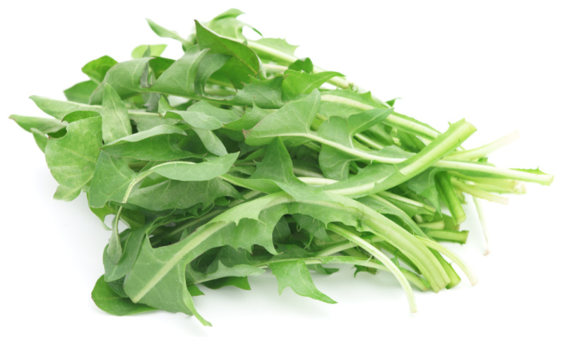 Prebiotic foods – Dandelion greens isolated on white.