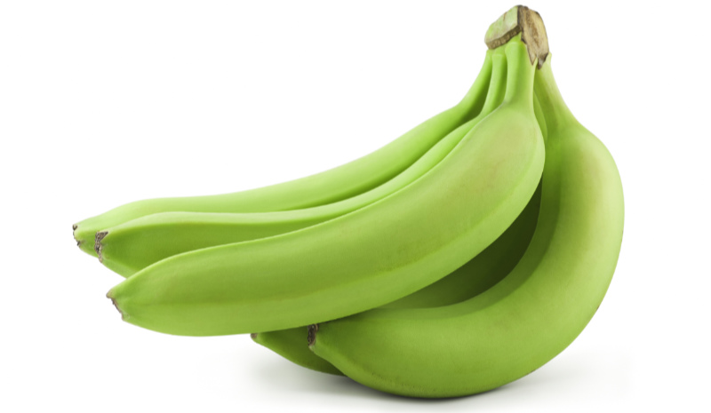 Prebiotic foods – Green unripe bananas isolated on white. Includes clipping path.