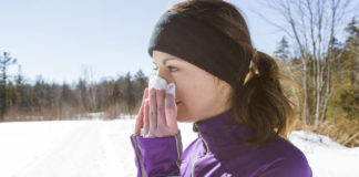 Woman exercising with a cold