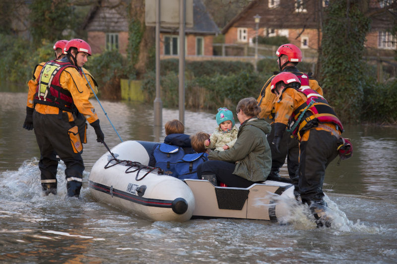 Children are rescued from flood waters