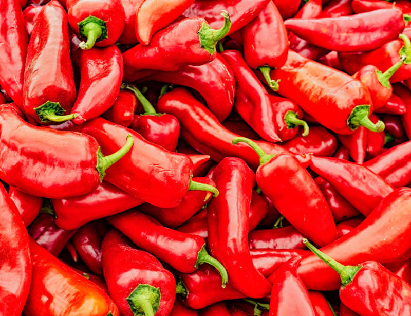 Warm foods Stack of red poblano peppers for sale in market
