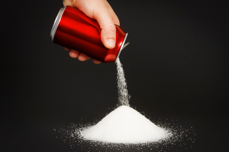 Unhealthy food concept - sugar in carbonated drinks.