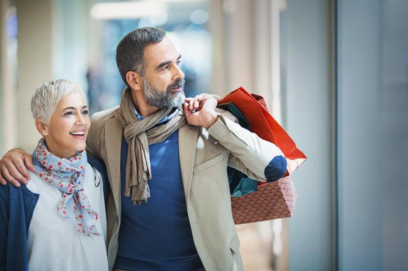 Senior couple out shopping on Black Friday