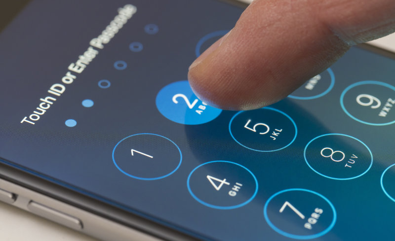 Photo showing a person entering passwords on an iPhone
