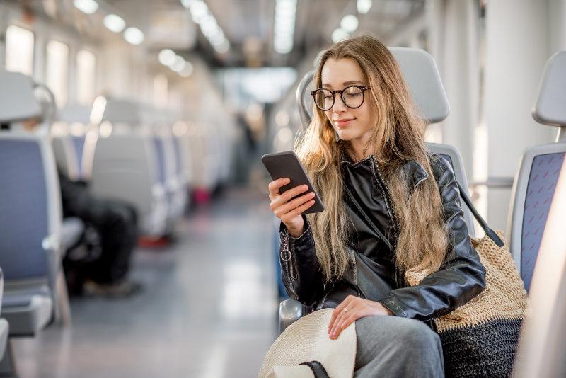 Backache prevention woman sitting on a train