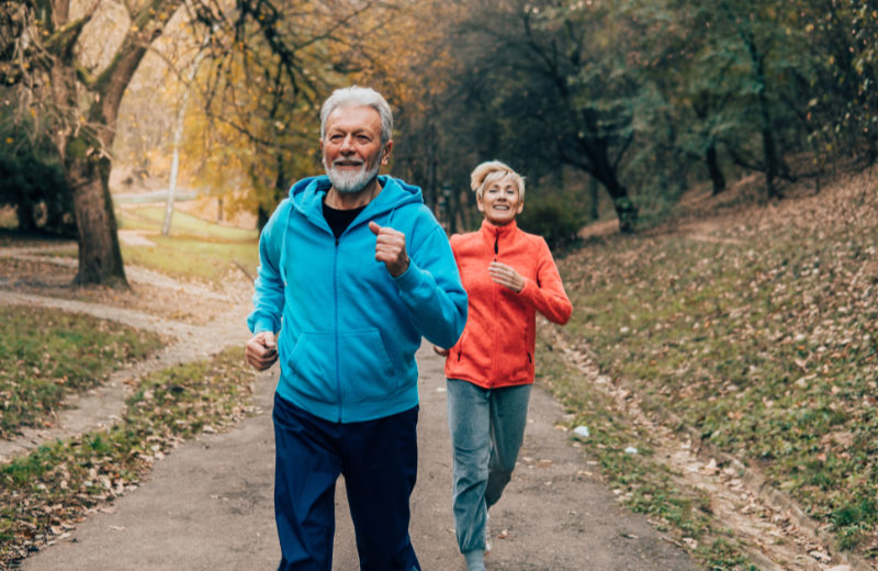 Reduce dementia risk Fit couple jogging together in the park