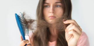 Stress and hair loss woman upset at hair loss