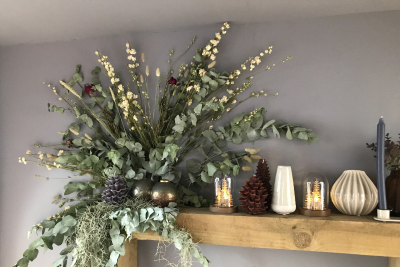 Yuletide mantelpiece natural leaves