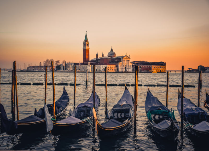 best-European-cities-to-visit-in-winter-Sunset over famous Venice canal