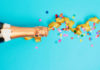 Bottle of cheap champagne with party ribbon (iStock/PA)
