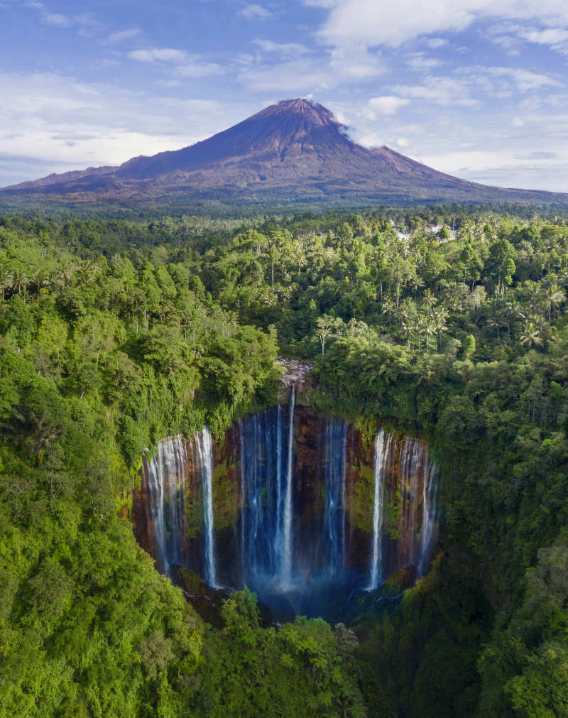 Famous waterfalls Aerial view of Semeru mountain with Tumpak Sewu waterfall located in Lumajang, Indonesia