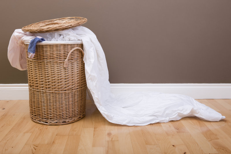 Bed sheets in a laundry basket