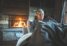 Woman cosy concept for how to keep your home warm during winter