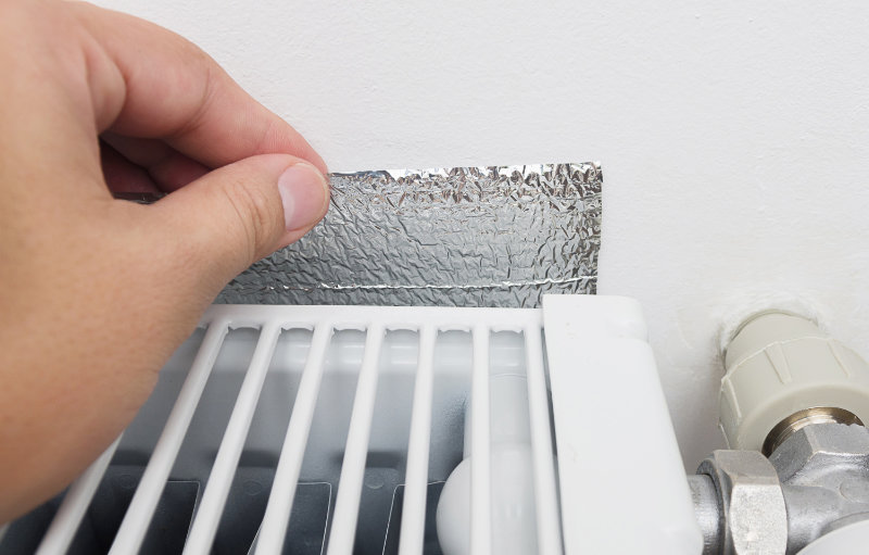 Reflect heat back into your home by sticking foil behind radiators.
