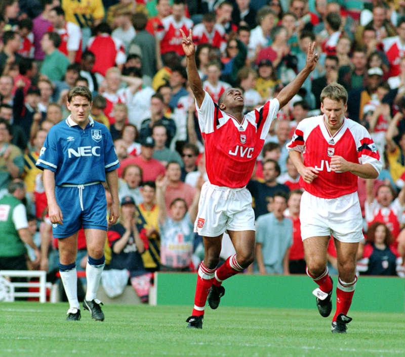 Ian Wright, of Arsenal (centre) celebrates after scoring his second goal against Everton at Highbury (John Stillwell/PA)
