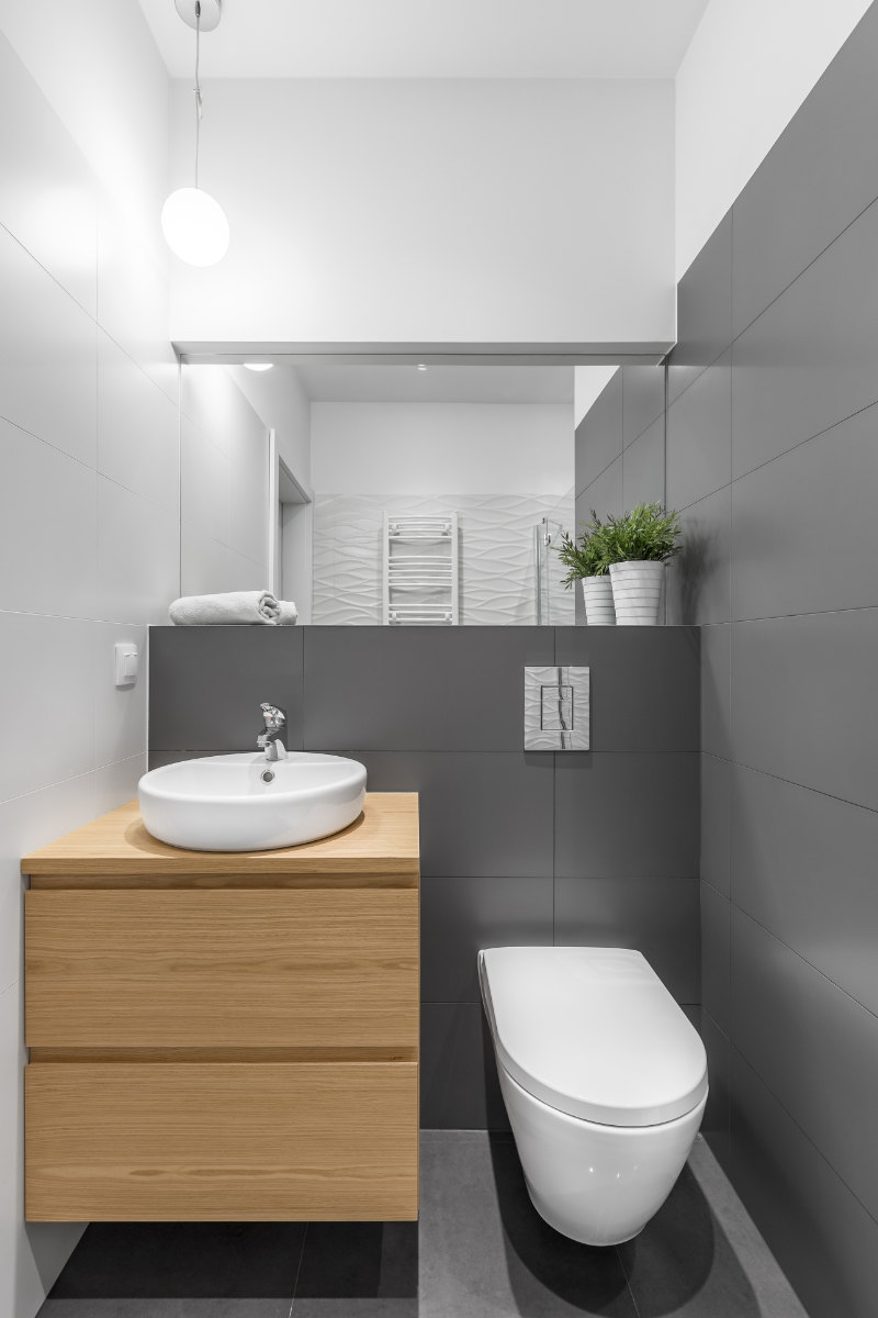 Add value to your home with an extra bathroom Small grey and white bathroom