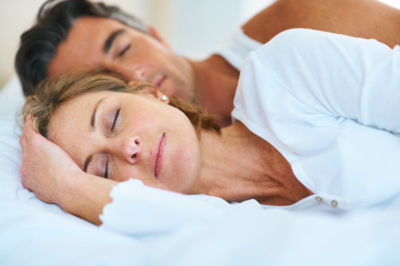Cut calories sleep more Attractive mature couple sleeping in bed together