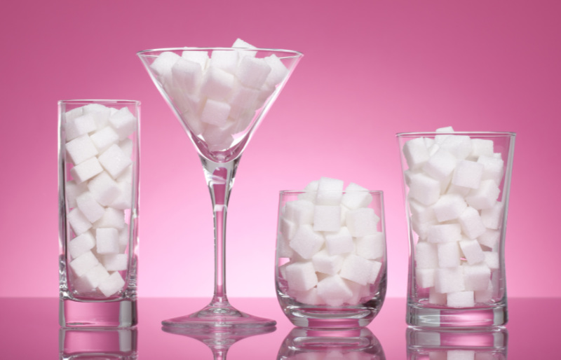Ditch sugar watch your alcohol intake Four glasses with sugar cubes