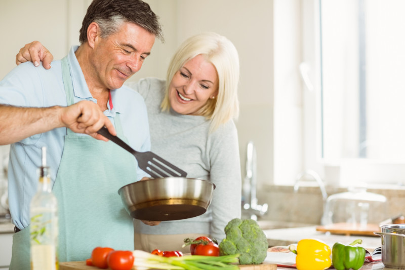 Ditch sugar Mature couple making dinner together at home in the kitchen