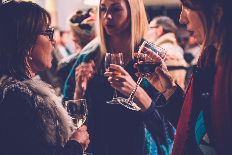 Dry January Women talking and having fun in wine bar at a social gathering