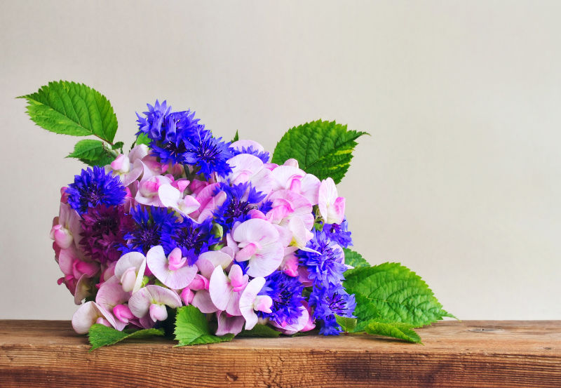 Gardening helps make friends Leave bunches of summer flowers such as sweet peas for neighbours