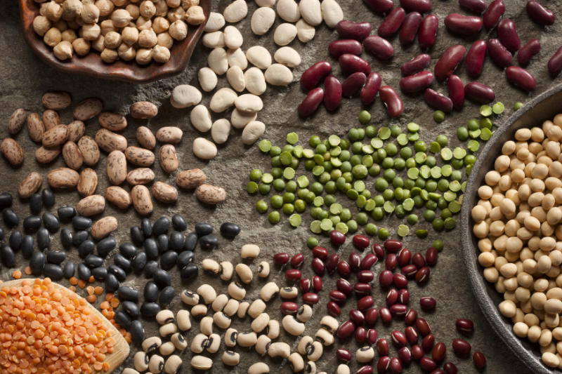 High fibre foods Piles of a variety of healthy organic legumes.