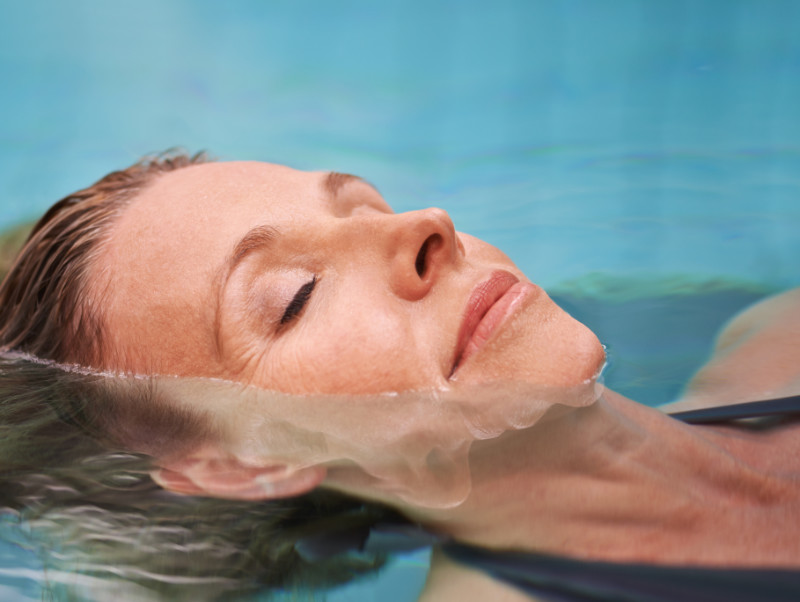 Mental health benefits of swimming Cropped shot of a mature woman relaxing in an indoor swimming pool