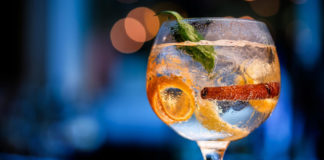 gin on bar counter with blurred background in shades of blue.