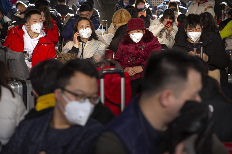 Symptoms are similar to that of the flu (Mark Schiefelbein/AP)