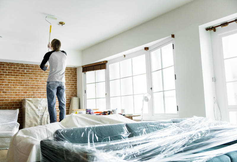 How to start painting a room well involves starting on the ceiling.